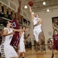 Bentonville's Austin Heard takes the ball to the basket over Springdale's Brendan Cook during the Ti...