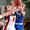 Ashley Ward, left, a Rogers Heritage senior, and Rogers High senior McKinzie James vie for a rebound...