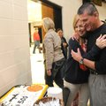 David Ferrell, right, West Fork boys coach, hugs his wife, Kelly Ferrell, while celebrating his 500t...