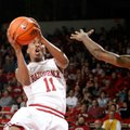 Arkansas sophomore BJ Young attempts a shot around Mississippi State freshman Fred Thomas on Wednesd...
