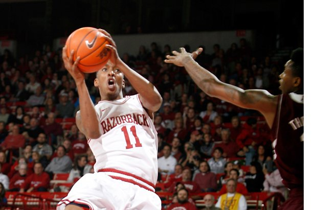 arkansas-sophomore-bj-young-attempts-a-shot-around-mississippi-state-freshman-fred-thomas-on-wednesday-jan-23-2013-at-bud-walton-arena-in-fayetteville