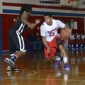 Little Rock Parkview's Anton Beard (33) tries to dribble around Little Rock Hall defender Javon Perr...