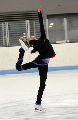 Amanda Thomsen, 10, attempts a Biellmann spin during the Ozark Figure Skating Club's ice time at the Jones Center in Springdale. The OFSC formed in 1997 and became a member of U.S. Figure Skating in 1999. The club is open to all skaters from novice to advanced.