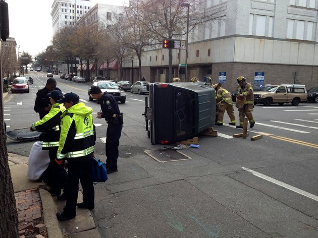 authorities-work-the-scene-wednesday-jan-23-2013-after-a-car-overturned-at-capitol-and-center-streets-in-downtown-little-rock