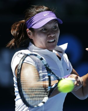 Li Na of China took advantage of double-faults by second-seeded Maria Sharapova on the first two points and advanced into her second Australian Open final with a 6-2, 6-2 victory.