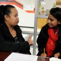 Mandy Ritok, Marshallese liaison for the Springdale School District, talks Wednesday with Ancelitha ...