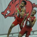 NWA Media/MICHAEL WOODS --01/25/2013-- Arkansas runner Akheem Gauntlett (front) and Nebraska runner ...