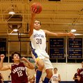Photo by Randy Moll -- Decatur senior forward Andrew Harris breaks away from Hartford's Brody Funk a...