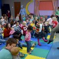 "Caitlyn Walsh leads children Thursday in a game of ""Hokey Pokey"" between reading stories during Todd..."