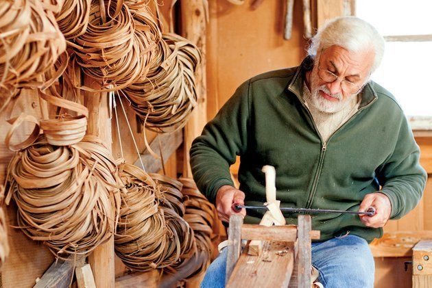 owen-rein-makes-chairs-and-baskets-using-traditional-tools-at-his-home-in-the-woods-near-mountain-view-hes-known-for-his-rocking-chairs-made-from-trees-that-he-cuts-on-his-property-rein-uses-a-draw-knife-to-fashion-parts-for-a-chair