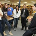 Matt de la Pena, right, talks Thursday with Har-Ber High School juniors after speaking at Southwes...