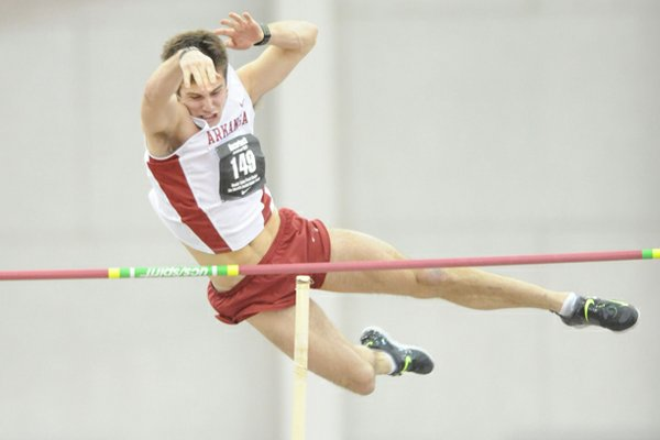 Arkansas' Kevin Lazas competes in the pole vault portion of the heptathlon Saturday, Jan. 26, 2013, during the Razorback Invitational at the Randal Tyson Track Center in Fayetteville.