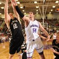Tyler McCullough, right, a Fayetteville senior and Bentonville senior guard Austin Heard reach for a...