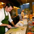 Matt McClure, executive chef, preps one of the stations Thursday in the kitchen of The Hive. The Hiv...