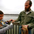 Kevin Bennoch pours water and plankton samples Friday into a container held by Owl Creek School fift...