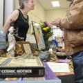 Vick Kelley, right, with The Goddess Festival, talks with Carlous Guthrie during the opening of the ...
