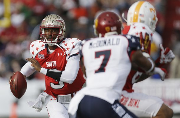 senior-bowl-south-squad-quarterback-ej-manuel-of-florida-state-3-looks-for-a-receiver-as-north-squad-defensive-back-tj-mcdonald-of-usc-7-covers-south-squad-tight-end-mychal-rivera-of-tennessee-81-in-the-first-half-of-the-senior-bowl-college-football-game-at-ladd-peebles-stadium-in-mobile-ala-saturday-jan-26-2013-ap-photodave-martin