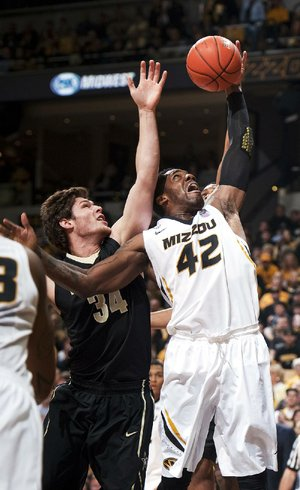 Missouri's Alex Oriakhi (42) grabs a rebound in front of Vanderbilt's Shelby Moats (34) in the first half of the Tigers' 81-59 victory Saturday in Columbia, Mo. Oriakhi had 18 points and a game-high 12 rebounds in the victory.