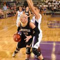 Julia Garrard of Bentonville attempts to score around Fayetteville's Vanessa Matlock on Friday in Fa...