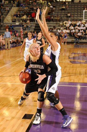 Julia Garrard of Bentonville attempts to score around Fayetteville's Vanessa Matlock on Friday in Fayetteville.