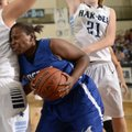 Taylor Strickland, center, of Rogers High pushes into Springdale Har-Ber's Tayleah Neal while drivin...