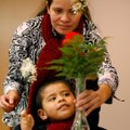 Carminda Gomez helps son, Pablo Gomez, 3, piece together a flower arrangement Saturday at the Spring...