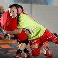 Brendan Davis, left, 12, and Gavin Goddard, 10, wrestle during practice Jan. 21 inside The Annex in ...