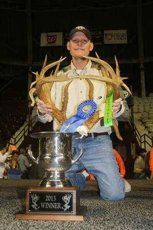 Mike Miller of Marion won the Arkansas Big Buck Classic with a rack that netted 215 6/8 Boone and Crockett. Miller killed the buck with a crossbow that he used for the first time.