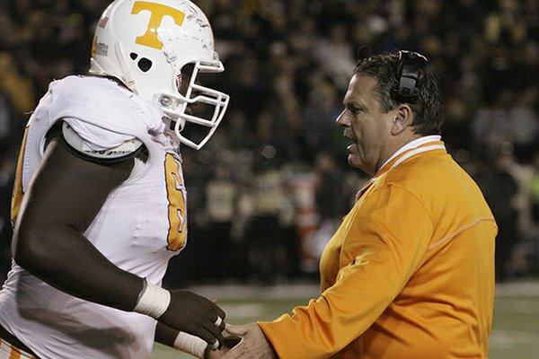 Arkansas offensive line coach Sam Pittman, who coached at Tennessee in 2012, was pivotal in Dan Skipper's decision to switch verbal commitments from the Volunteers to the Razorbacks. (Chattanooga Times/Patrick Smith)