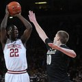 NWA MEDIA/SAMANTHA BAKER -- Arkansas' Jacorey Williams, left, shoots over Josh Henderson of Vanderbi...