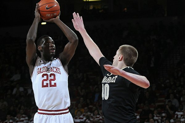 NWA MEDIA/SAMANTHA BAKER -- Arkansas' Jacorey Williams, left, shoots over Josh Henderson of Vanderbilt Saturday, Jan. 12, 2013, at Bud Walton Arena.