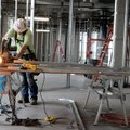 Josh Rainey with Dewitt Construction of Springfield, Mo., cuts a metal beam to build a wall Monday a...