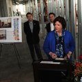 Karen Parker, from right, senior manager with the Walmart Foundation, gives a few remarks Monday as ...