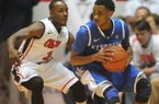 Kentucky's Ryan Harrow (12) works against Mississippi's Derrick Millinghaus (3) during an NCAA college basketball game Tuesday, Jan. 29, 2013, in Oxford, Miss. (AP Photo/Oxford Eagle, Bruce Newman)