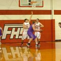 MARK HUMPHREY STAFF PHOTO -- Berryville's 6-foot-6 center, Josh Morrell, works against a Farmington ...