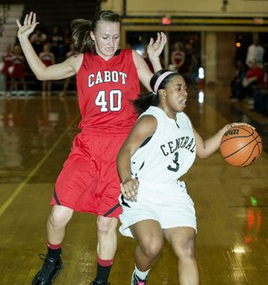 Central's Taylor Lewis (4) tries to outrun Cabot's Taylor Elliot (40) during the Cabot v. Central game held Tuesday night at Central High School.