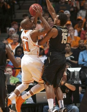 Tennessee guard Trae Golden (11) goes up for a basket as Vanderbilt guard Kevin Bright (15) defends during the first half of an NCAA college basketball game Tuesday, Jan. 29, 2013, in Knoxville, Tenn. (AP Photo/Knoxville News Sentinel, Adam Brimer)