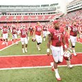 STAFF PHOTO ANDY SHUPE -- Arkansas running back Knile Davis (7) walks off the field after the Razorb...