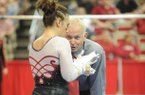 NWA Media/ANDY SHUPE -- Arkansas co-head coach Mark Cook speaks to senior Amy Borsellino before her performance on the bars during a meet with Georgia Friday, Jan. 11, 2013, in Barnhil Arena on the UA campus in Fayetteville.