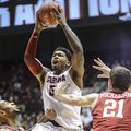 Alabama guard Trevor Lacey (5) takes a leaping shot during an NCAA college basketball game against A...
