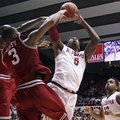 Alabama guard Trevor Lacey (5) takes a shot while Arkansas guard Rickey Scott (3) blocks during an N...