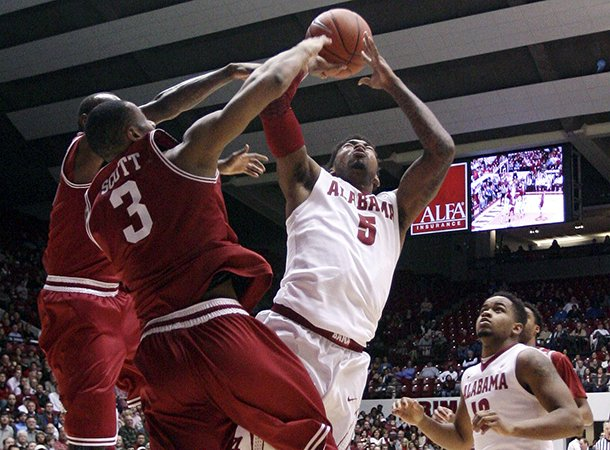 alabama-guard-trevor-lacey-5-takes-a-shot-while-arkansas-guard-rickey-scott-3-blocks-during-an-ncaa-college-basketball-game-in-tuscaloosa-ala-thursday-jan-31-2013-ap-phototuscaloosa-news-michelle-lepianka-carter