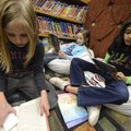 Emily Hornick, 8, from left, Madison Rector, 8, and Neha Soman, 9, all third-graders, read books the...