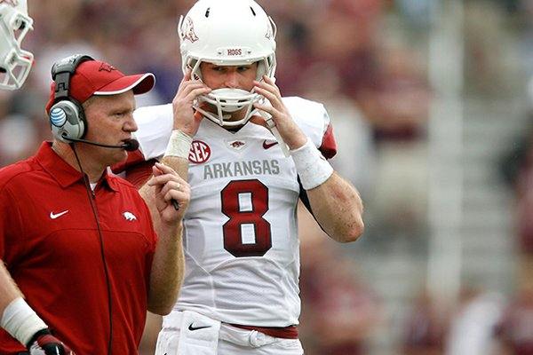 NWA Media/JASON IVESTER -- Arkansas offensive coordinator Paul Petrino talks to quarterback Tyler Wilson during the second quarter against Texas A&M on Saturday, Sept. 29, 2012, at Kyle Field in College Station, Texas.