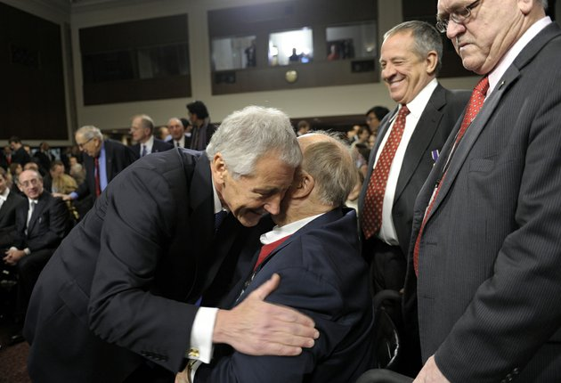 former-nebraska-republican-sen-chuck-hagel-left-president-barack-obamas-choice-for-defense-secretary-greets-former-georgia-sen-max-cleland-center-after-arriving-on-capitol-hill-in-washington-thursday-jan-31-2013-to-testify-before-the-senate-armed-services-committee-hearing-on-his-nomination