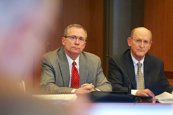 Arkansas Athletic Director Jeff Long (left) and Donald Pederson, vice chancellor for finance and administration, answer questions concerning expansion plans to Reynolds Razorback Stadium at a meeting of the UA board of trustees Thursday.