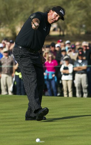 Phil Mickelson watches a putt on the ninth green lip out of the cup Thursday at the Phoenix Open in Scottsdale, Ariz. Had he made it, the putt would have given Mickelson a 59.