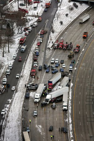 Vehicles sit in a tangle after a whiteout Thursday caused a mile long series of crashes along Interstate 75 on the southwest side of Detroit.