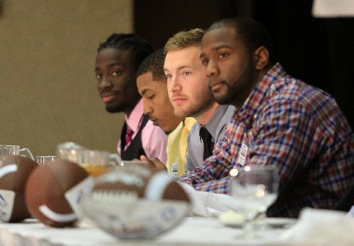 award-winners-left-to-right-jimmy-jean-of-arkansas-baptist-jamal-nixon-of-the-university-of-arkansas-monticello-tanner-marsh-of-arkansas-tech-and-kelvin-martin-of-harding-listen-to-introductions-friday-afternoon-during-the-little-rock-touchdown-club-awards-banquet