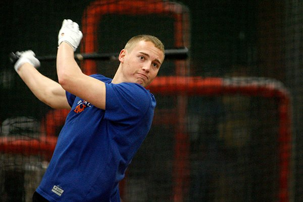 NWA Media/JASON IVESTER -- Brandon Nimmo takes batting practice in the batting cages while training on Wednesday, Jan. 30, 2013, at Baum Stadium in Fayetteville. Nimmo is currently an outfielder in the New York Mets organization.